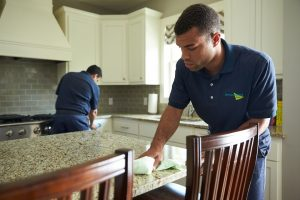 ServiceMaster Technicians Cleaning high-touch surfaces while disinfection cleaning